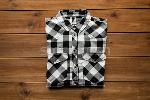 checkered shirt on wooden background Stock photo © dolgachov