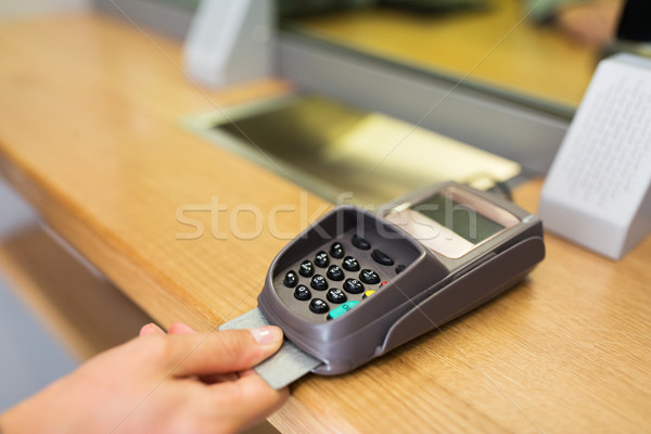 close up of hand inserting bank card to terminal Stock photo © dolgachov