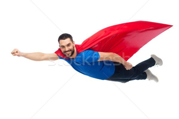 Feliz hombre rojo vuelo aire Foto stock © dolgachov