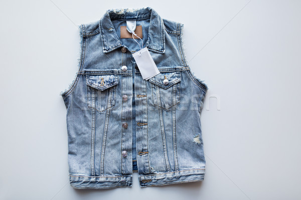 denim vest or waistcoat with price tag on white Stock photo © dolgachov