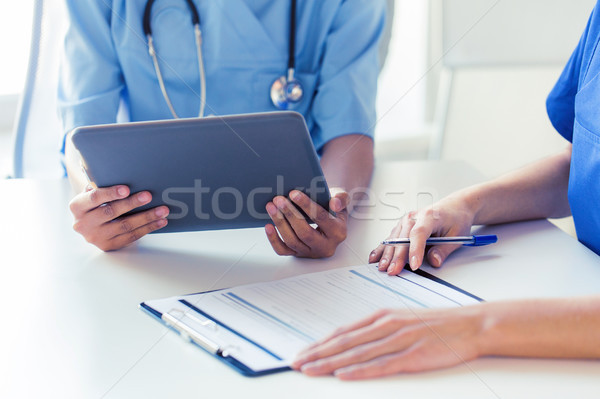 Stock photo: close up of doctors with tablet pc at hospital