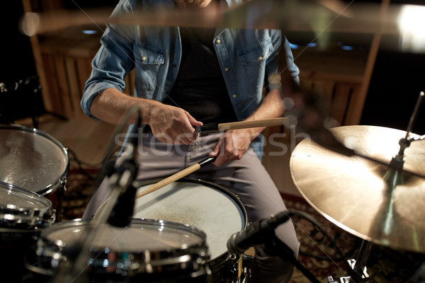 Stock photo: male musician playing drums and cymbals at studio