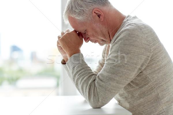 Stock photo: close up of senior man thinking