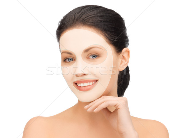 beautiful young woman with collagen facial mask Stock photo © dolgachov