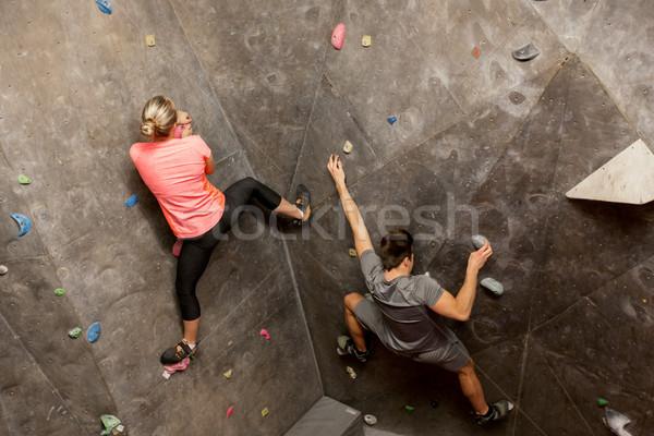 man and woman exercising at indoor climbing gym Stock photo © dolgachov