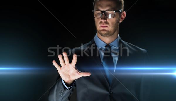 üzletember megérint valami képzeletbeli üzletemberek jövő Stock fotó © dolgachov