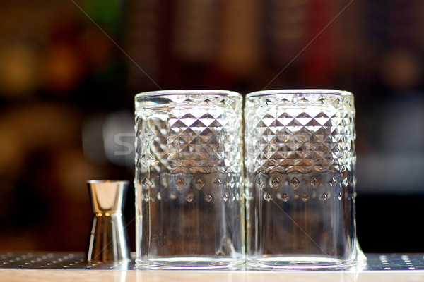 two vintage glasses and jigger on bar counter Stock photo © dolgachov