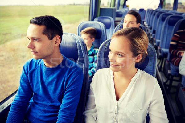 happy couple or passengers in travel bus Stock photo © dolgachov
