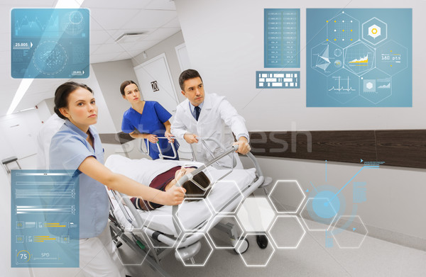 medics with woman on hospital gurney at emergency Stock photo © dolgachov