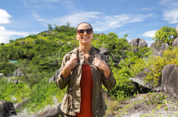 happy young woman with backpack traveling Stock photo © dolgachov