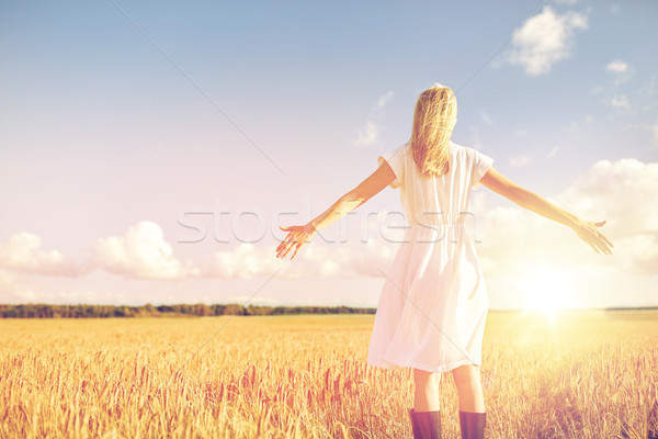 happy young woman in white dress on cereal field Stock photo © dolgachov