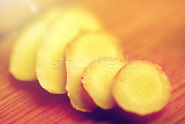 close up of ginger root on wooden table Stock photo © dolgachov