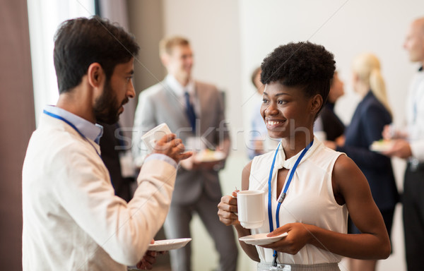 business people with conference badges and coffee Stock photo © dolgachov