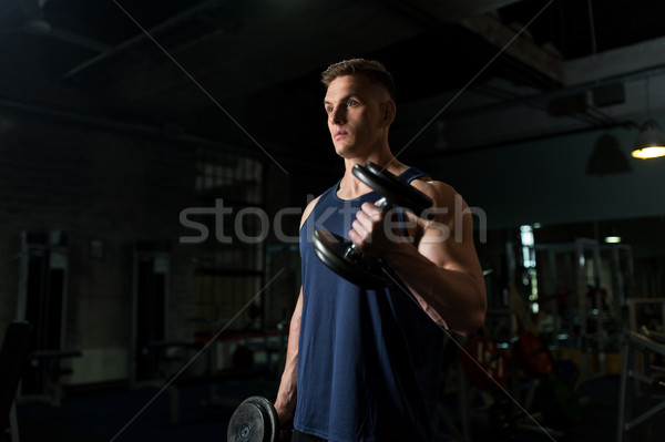 Giovane manubri palestra sport bodybuilding Foto d'archivio © dolgachov