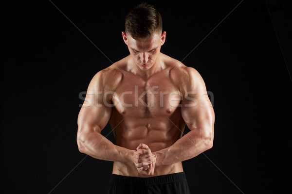 young man or bodybuilder with bare torso Stock photo © dolgachov