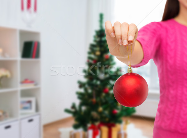 Stock photo: close up of woman hand with christmas ball
