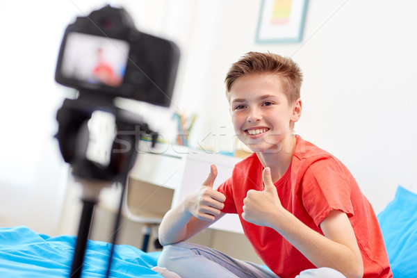 happy boy with camera recording video at home Stock photo © dolgachov