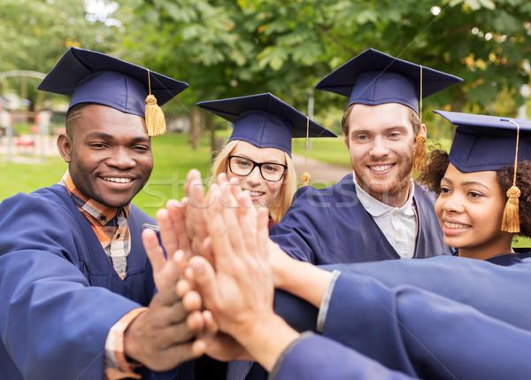Heureux élèves high five éducation graduation Photo stock © dolgachov