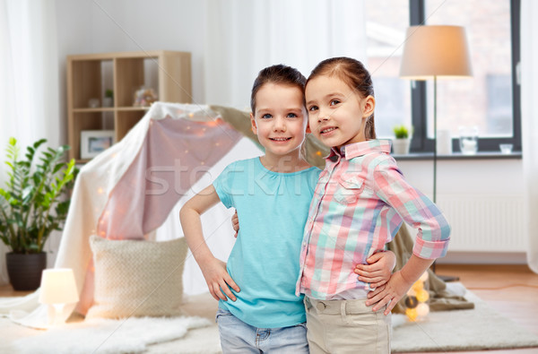 happy smiling little girls hugging at home Stock photo © dolgachov