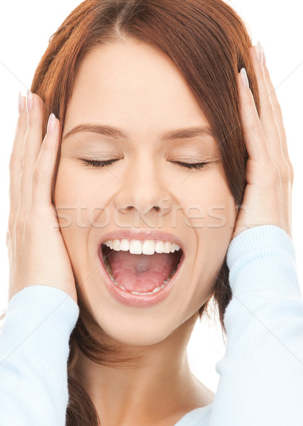 woman with hands on ears Stock photo © dolgachov