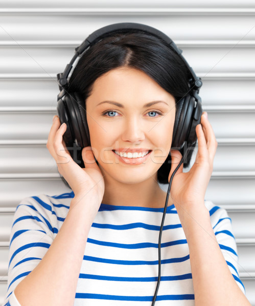 happy teenage girl in big headphones Stock photo © dolgachov