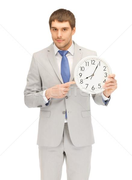 man with clock Stock photo © dolgachov