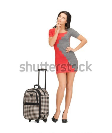 pensive woman with suitcase and book Stock photo © dolgachov