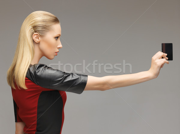 woman with access card Stock photo © dolgachov