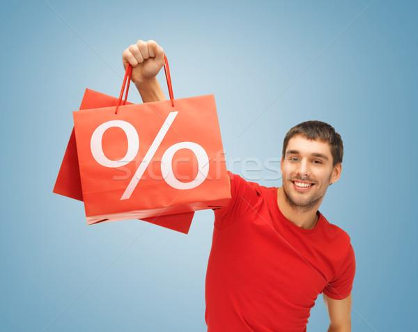 Férfi bevásárlótáskák kép jóképű férfi boldog vásárlás Stock fotó © dolgachov