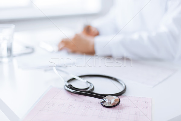 male doctor hands with cardiogram Stock photo © dolgachov
