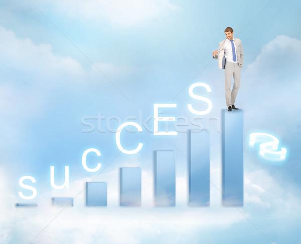 businessman with big 3d chart Stock photo © dolgachov