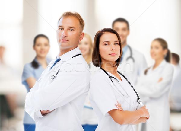 Dwa lekarzy opieki zdrowotnej medycznych kobieta muzyka Zdjęcia stock © dolgachov