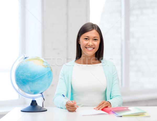 Nauczyciel świecie notatnika szkoły edukacji podróży Zdjęcia stock © dolgachov