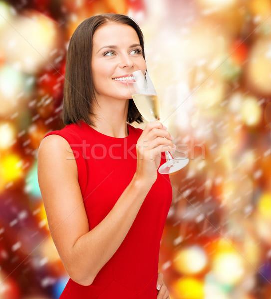 женщину красное платье стекла шампанского вечеринка напитки Сток-фото © dolgachov