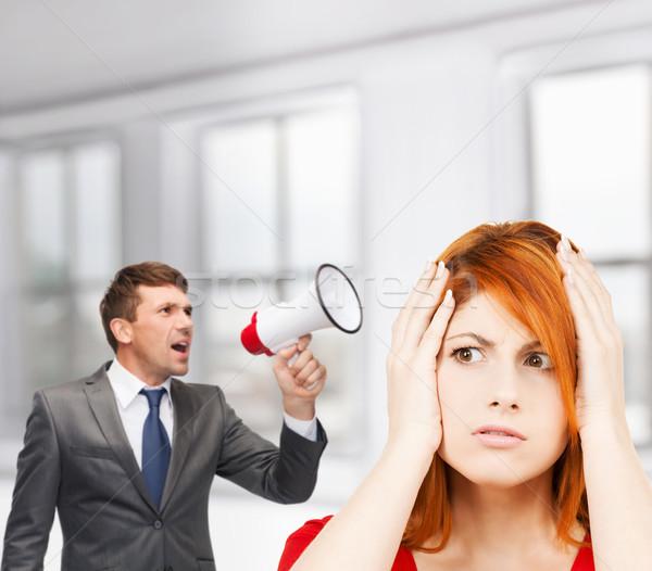 buisnessman with bullhorn and stressed woman Stock photo © dolgachov