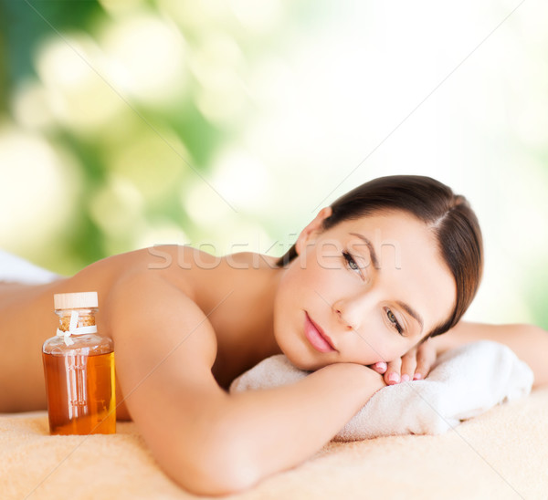 happy woman in spa salon Stock photo © dolgachov