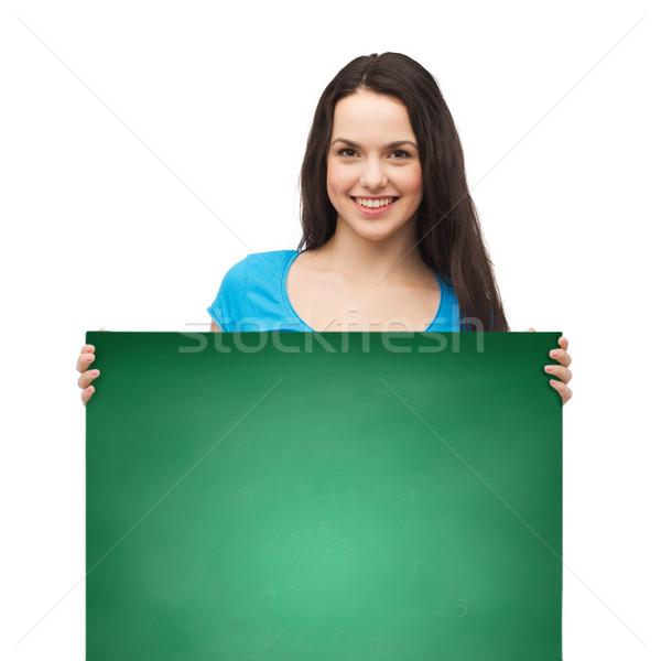 笑みを浮かべて 若い女の子 ホワイトボード 広告 販売 人 ストックフォト © dolgachov