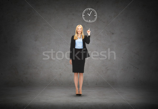 Stock photo: attractive young businesswoman with her finger up