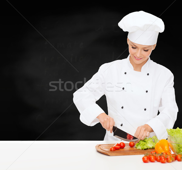 smiling female chef chopping vagetables Stock photo © dolgachov