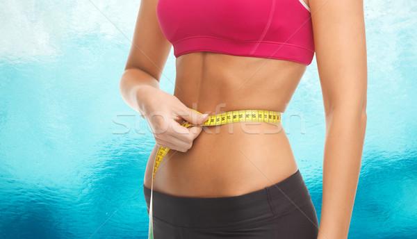 Közelkép képzett has mérőszalag fitnessz diéta Stock fotó © dolgachov