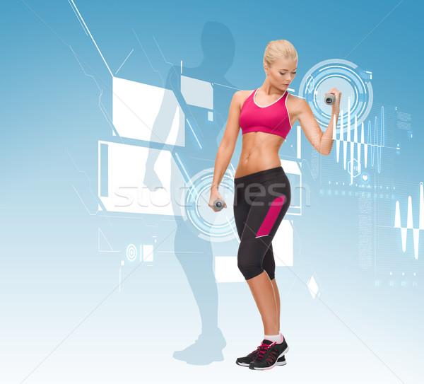 молодые женщину свет гантели фитнес Сток-фото © dolgachov
