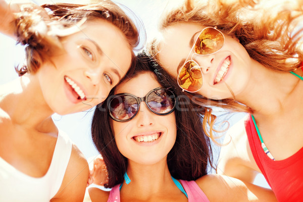 Stock photo: girls faces with shades looking down