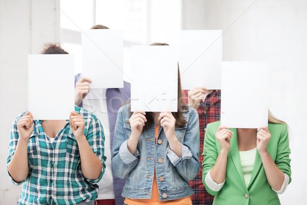 Stock fotó: Diákok · arcok · papírok · oktatás · csoport · nők