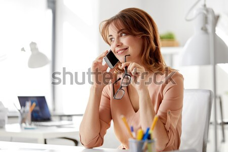 angry woman with phone Stock photo © dolgachov