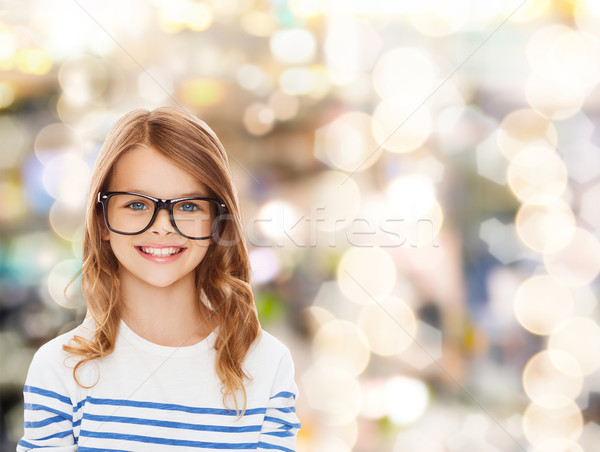 smiling cute little girl with black eyeglasses Stock photo © dolgachov