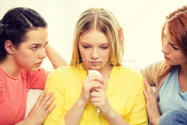 two teenage girls comforting another after breakup Stock photo © dolgachov