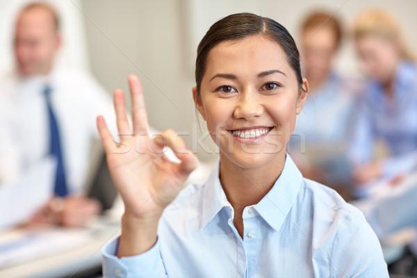 Grupo sonriendo reunión oficina gente de negocios Foto stock © dolgachov