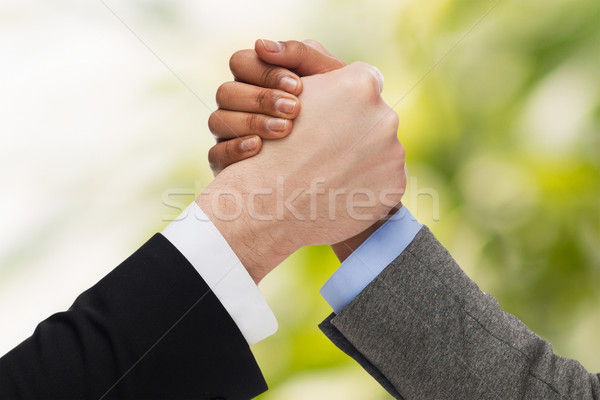 hands of two people arm wrestling Stock photo © dolgachov