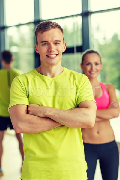 улыбаясь человека женщину спортзал спорт фитнес Сток-фото © dolgachov