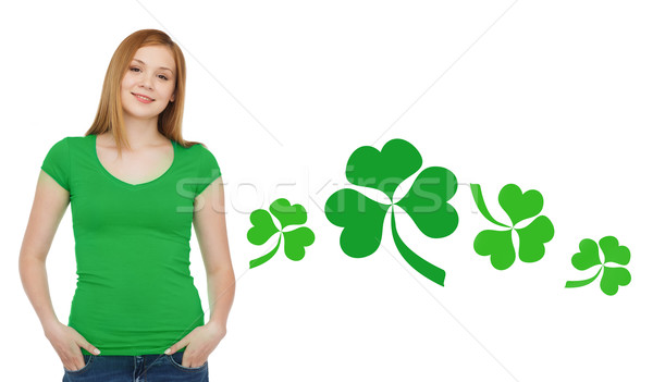smiling teen girl in green t-shirt with shamrock Stock photo © dolgachov